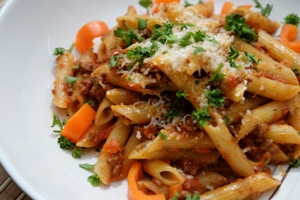 a bowl of Bolognese Sauce on penne pasta