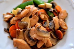 A plate of Moo Goo Gai Pan, chicken and mushrooms.