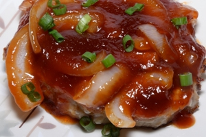 A dish containing Chinese Style Pork Chops in Sweet Onion Sauce